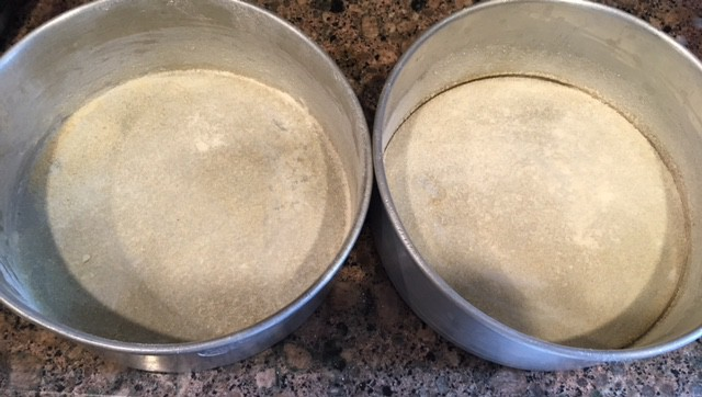 Greased and Dusted 2 baking pans of 6'' each