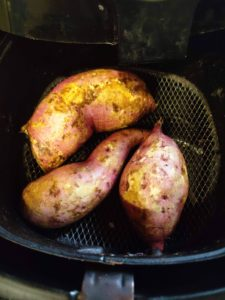 Sweet potatoes being roasted in air fryer