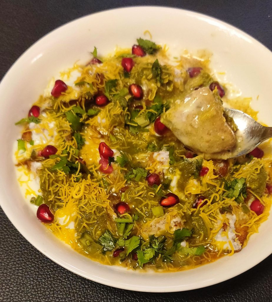 Top it with whisked curd, meethi chutney etc